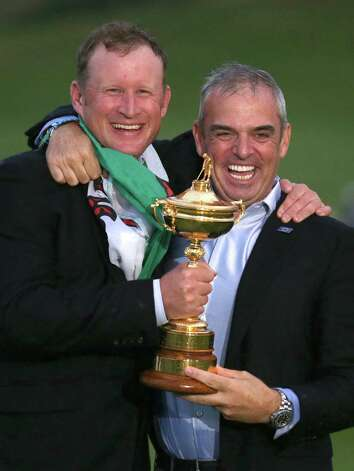 Europe team captain Paul McGinley, right, holds the trophy with Europe's Jamie Donaldson after winning the 2014 Ryder Cup golf tournament at Gleneagles, Scotland, Sunday, Sept. 28, 2014.  (AP Photo/Peter Morrison) ORG XMIT: RCUP326 Photo: Peter Morrison / AP