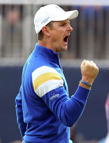 Europe's Justin Rose celebrates his putt on the 4th green during the singles match on the final day of the Ryder Cup golf tournament, at Gleneagles, Scotland, Sunday, Sept. 28, 2014. (AP Photo/Peter Morrison) ORG XMIT: RCUP165 Photo: Peter Morrison / AP