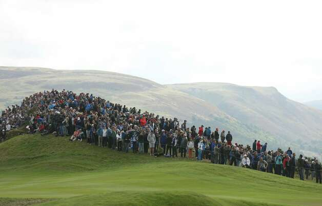 Spectators on a hillside overlooking the 7th fairway watch the singles match on the final day of the Ryder Cup golf tournament, at Gleneagles, Scotland, Sunday, Sept. 28, 2014. (AP Photo/Peter Morrison) ORG XMIT: RCUP177 Photo: Peter Morrison / AP