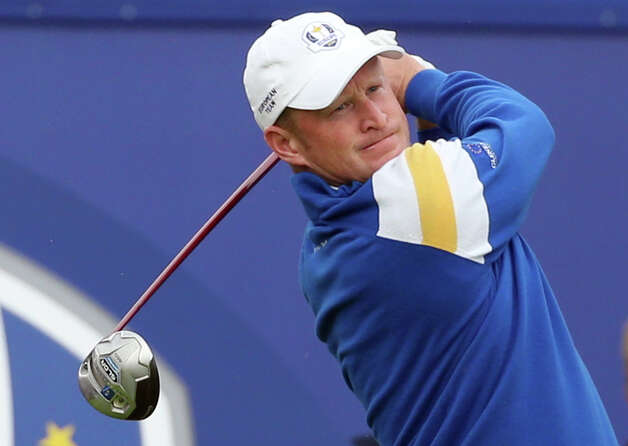 Europe's Jamie Donaldson plays a shot off the 1st tee during the singles match on the final day of the Ryder Cup golf tournament, at Gleneagles, Scotland, Sunday, Sept. 28, 2014. (AP Photo/Scott Heppell) ORG XMIT: RCUP198 Photo: Scott Heppell / AP