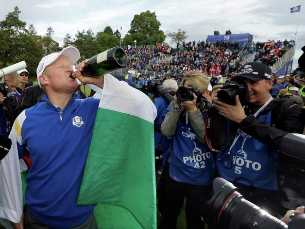 Europe's Jamie Donaldson drinks from a champagne bottle to celebrate his singles match to win the 2014 Ryder Cup golf tournament at Gleneagles, Scotland, Sunday, Sept. 28, 2014. (AP Photo/Matt Dunham) ORG XMIT: RCUP225 Photo: Matt Dunham / AP