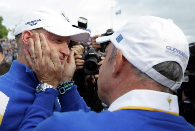 Europe team captain Paul McGinley, right, celebrates with Jamie Donaldson after he wins his singles match to win the 2014 Ryder Cup golf tournament at Gleneagles, Scotland, Sunday, Sept. 28, 2014. (AP Photo/Matt Dunham) ORG XMIT: RCUP218 Photo: Matt Dunham / AP