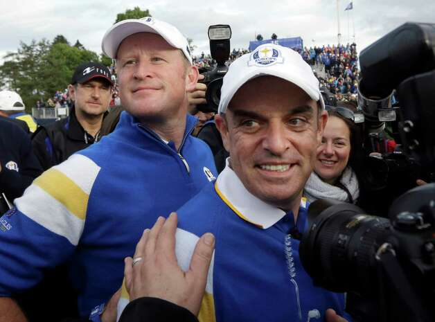 Europe team captain Paul McGinley, right, celebrates with Jamie Donaldson after he wins his singles match to win the 2014 Ryder Cup golf tournament at Gleneagles, Scotland, Sunday, Sept. 28, 2014. (AP Photo/Matt Dunham) ORG XMIT: RCUP220 Photo: Matt Dunham / AP