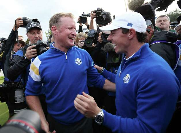 Europe's Jamie Donaldson, left, and Rory McIlroy celebrate winning the 2014 Ryder Cup golf tournament at Gleneagles, Scotland, Sunday, Sept. 28, 2014. (AP Photo/Peter Morrison) ORG XMIT: RCUP210 Photo: Peter Morrison / AP
