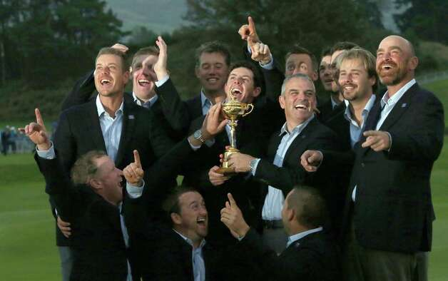 Europe team captain Paul McGinley, center right, and his team celebrate with the trophy after winning the Ryder Cup golf tournament at Gleneagles, Scotland, Sunday, Sept. 28, 2014. (AP Photo/Scott Heppell) ORG XMIT: RCUP325 Photo: Scott Heppell / AP