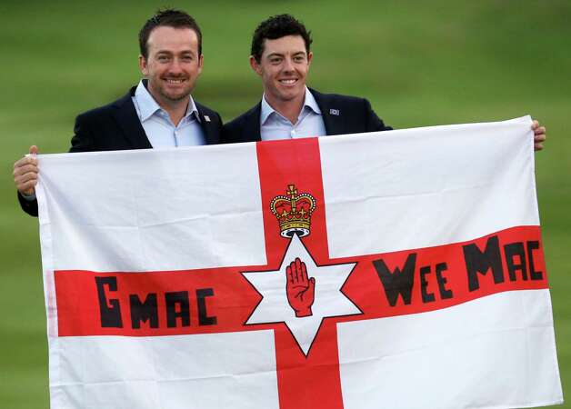 Europe's Graeme McDowell, left, and Rory McIlroy hold a Northern Ireland flag after winning the 2014 Ryder Cup golf tournament at Gleneagles, Scotland, Sunday, Sept. 28, 2014. (AP Photo/Peter Morrison) ORG XMIT: RCUP313 Photo: Peter Morrison / AP