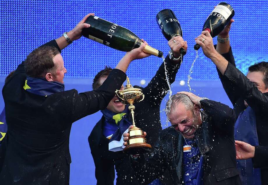 Members of the European team give captain Paul McGinley a bubbly shower after he guided Europe to another Ryder Cup win. Photo: BEN STANSALL, Staff / AFP
