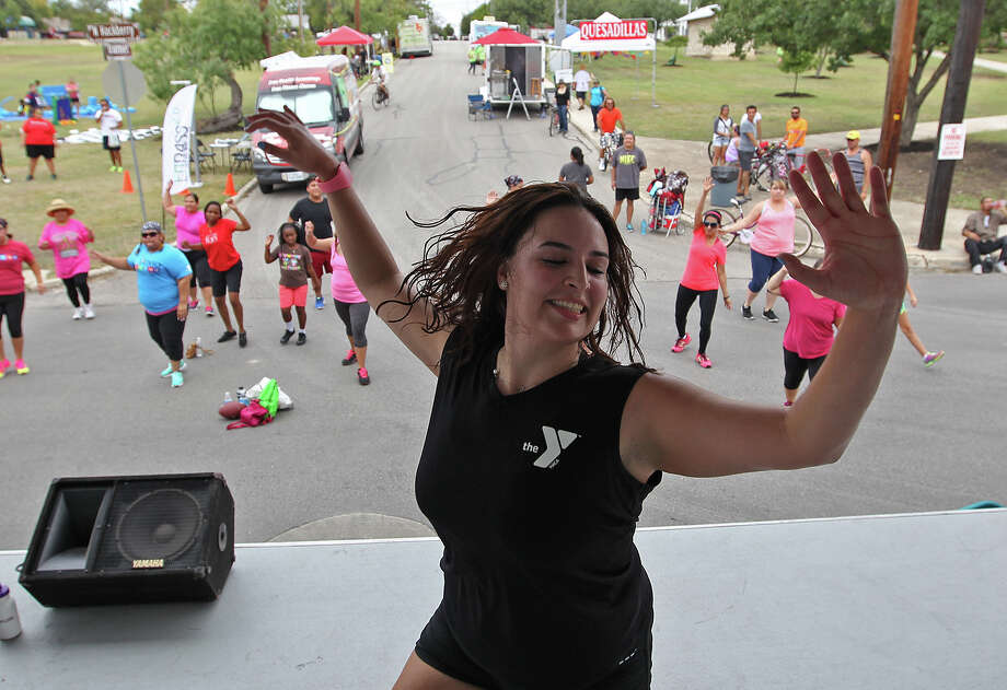 Sonya Reyna conducts a Zumba course at Dignowity and Lockwood Parks during this year's Siclovia, Sunday, Sept. 28, 2014. More than 65,000 were expected to participate in the event that closed off Broadway Street from downtown to East Mulberry. Photo: JERRY LARA, By Jerry Lara, San Antonio Express_News / © 2014 San Antonio Express-News