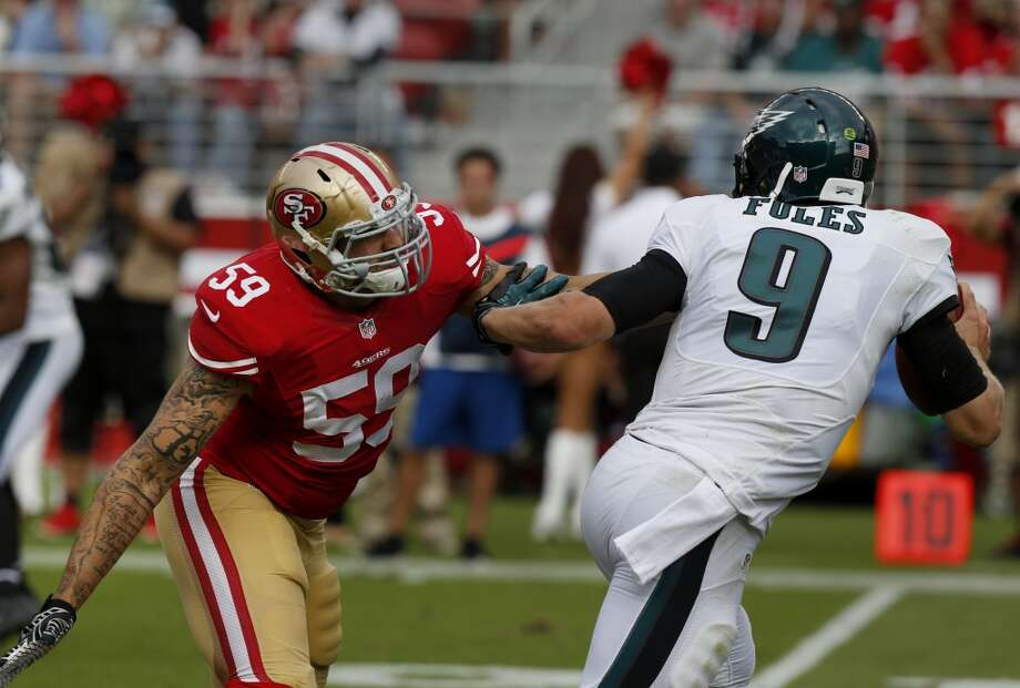 Aaron Lynch (59) got to Eagles quarterback Nick Foles (9) in the fourth quarter. The San Francisco 49ers defeated the Philadelphia Eagles 26-21 at Levi's Stadium Sunday September 28, 2014. Photo: The Chronicle