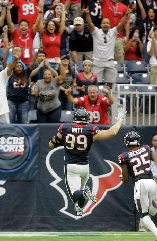 Houston Texans' J.J. Watt (99) celebrates as he returns an interception for a touchdown against the Buffalo Bills during the third quarter of an NFL football game, Sunday, Sept. 28, 2014, in Houston. (AP Photo/Patric Schneider) ORG XMIT: HTT131 Photo: Patric Schneider / FR170473 AP