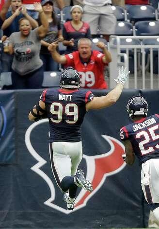 Houston Texans' J.J. Watt (99) celebrates as he returns an interception for a touchdown against the Buffalo Bills during the third quarter of an NFL football game, Sunday, Sept. 28, 2014, in Houston. (AP Photo/Patric Schneider) ORG XMIT: HTT136 Photo: Patric Schneider / FR170473 AP