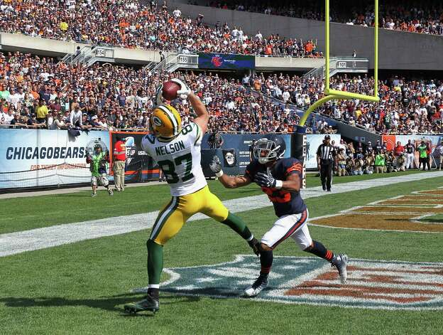 CHICAGO, IL - SEPTEMBER 28: Jordy Nelson #87 of the Green Bay Packers catches a touchdown pass in front of  Kyle Fuller #23 of the Chicago Bears during the second quarter at Soldier Field on September 28, 2014 in Chicago, Illinois. The Bears defetaed the Packers 38-17. (Photo by Jonathan Daniel/Getty Images) ORG XMIT: 504235405 Photo: Jonathan Daniel / 2014 Getty Images