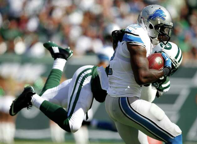 Detroit Lions wide receiver Jeremy Ross, front, avoids a tackle attempt by New York Jets cornerback Antonio Allen while scoring on a pass from quarterback Matthew Stafford during the first half of an NFL football game, Sunday, Sept. 28, 2014, in East Rutherford, N.J. (AP Photo/Kathy Willens) ORG XMIT: ERU106 Photo: Kathy Willens / AP