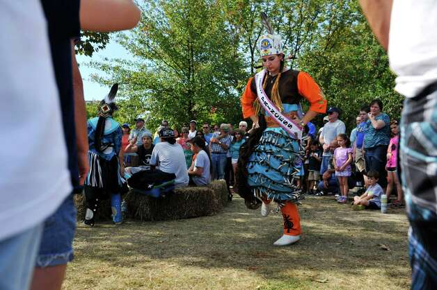 Ann Marie Spice, a member of the Stockbridge-Munsee Band of Indians performs a dance in a jingle dress  at the Corning Preserve during the Early Albany: A Hudson River Festival event on Sunday, Sept. 28, 2014, in Albany, N.Y.  A historical encampment was created on the banks of the Hudson River where visitors could see demonstrations on how Dutch settlers and the Native Americans in the area lived and worked during the early 1600's.      (Paul Buckowski / Times Union) Photo: Paul Buckowski / 00028422A