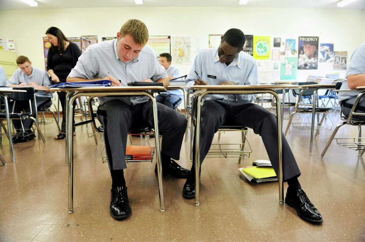 Seniors, John DeBonis, left, and Dillon Nimako works on problems in statistics class at LaSalle Institute on Wednesday, Sept. 17, 2014, in Troy, N.Y. The school is doing away with the Regents exams for students in grades 9-12. (Paul Buckowski / Times Union)