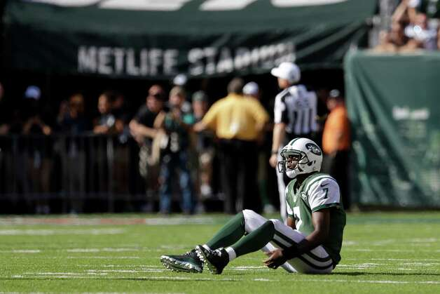 New York Jets quarterback Geno Smith sits on the ground after a pass was intercepted by Detroit Lions cornerback Darius Slay during the second half of an NFL football game, Sunday, Sept. 28, 2014, in East Rutherford, N.J. (AP Photo/Frank Franklin II) ORG XMIT: ERU122 Photo: Frank Franklin II / AP