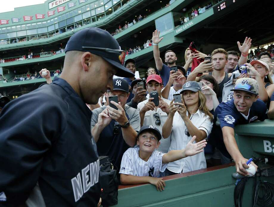 Fans greet Yankees shortstop Derek Jeter in Boston after the final game of his major league career. Photo: Elise Amendola / Associated Press / AP