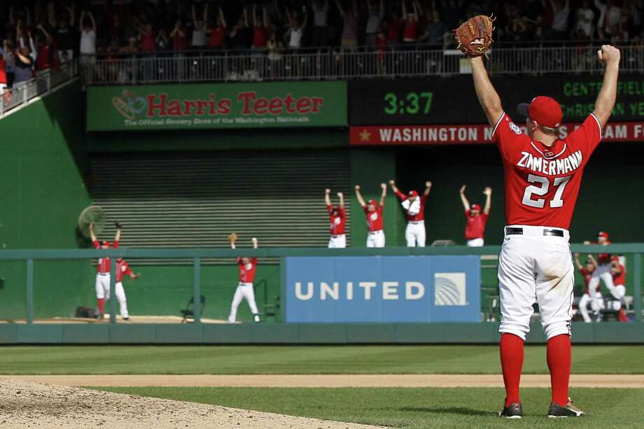 Washington's Jordan Zimmermann raises his arms after his no-hitter is secured with a diving catch. Photo: Alex Brandon / Associated Press / AP