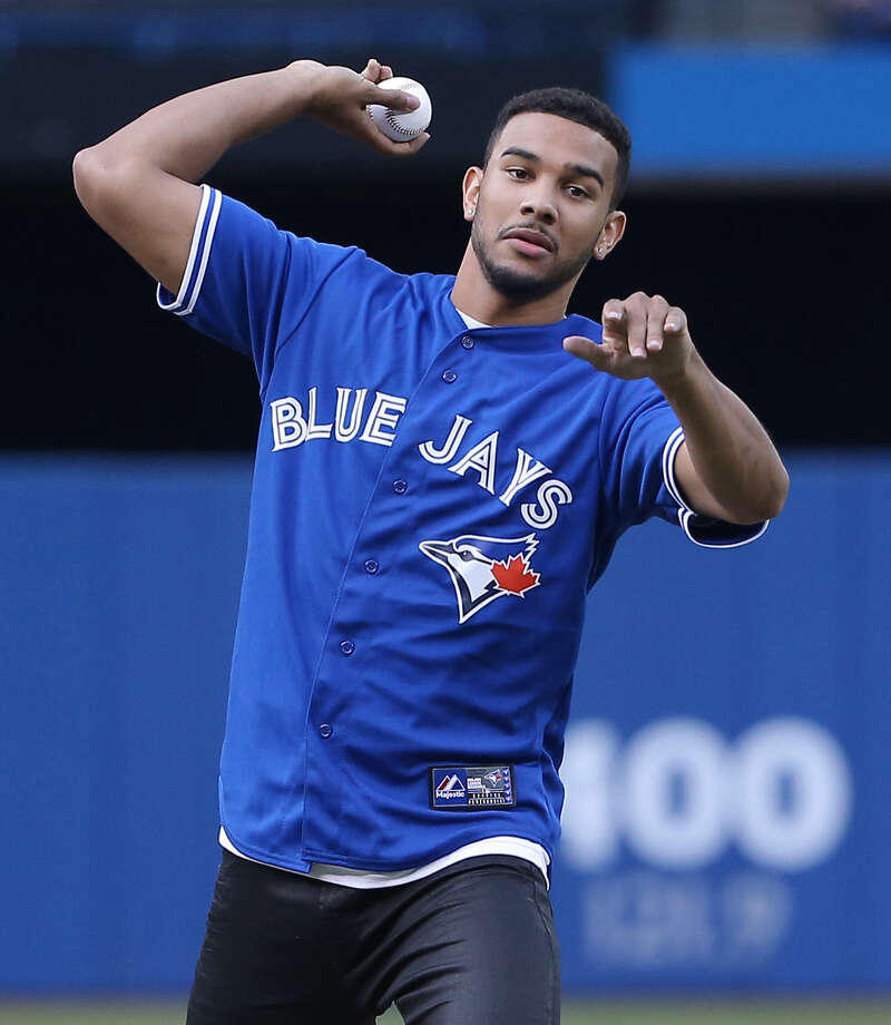 "Cory Joseph said he was nervous, but didn't ""50 Cent"" the first pitch during a Blue Jays game Aug. 29. Photo: Tom Szczerbowski / Getty Images / 2014 Tom Szczerbowski"