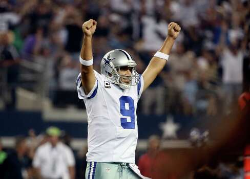 Dallas Cowboys' Tony Romo celebrates a touchdown runby DeMarco Murray during the second half of an NFL football game against the New Orleans Saints, Sunday, Sept. 28, 2014, in Arlington, Texas. (AP Photo/Brandon Wade) Photo: Brandon Wade, Associated Press / FR168019 AP