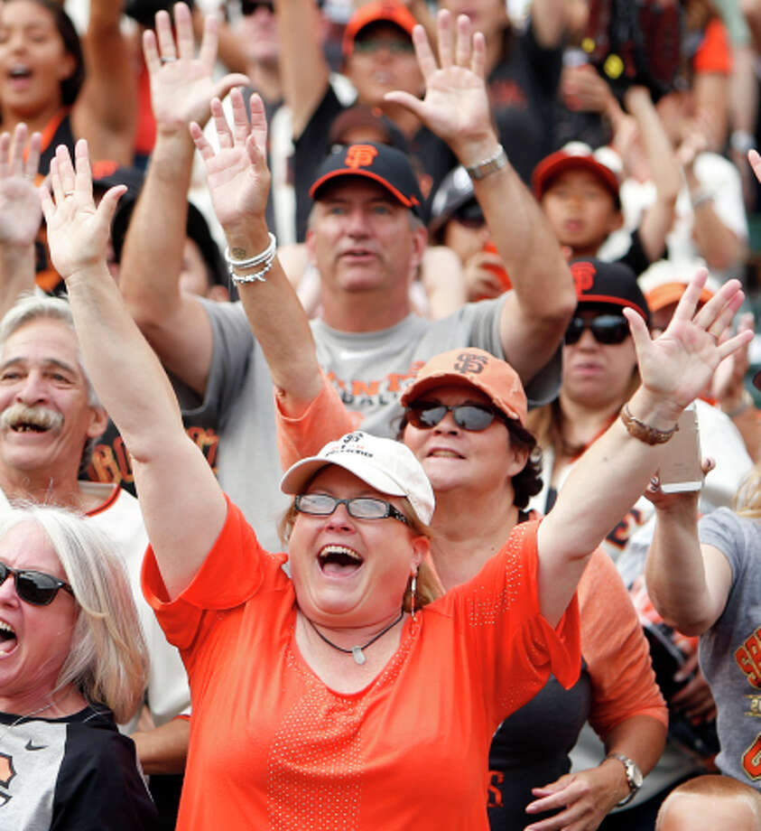 San Francisco Giants' fans yell for souvenirs after 9-3 win over San Diego Padres in MLB game at AT&T Park in San Francisco, Calif. on Sunday, September 28, 2014. Photo: Scott Strazzante / The Chronicle / ONLINE_YES
