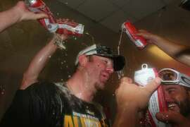 ARLINGTON, TX - SEPTEMBER 28:  Adam Dunn #10 of the Oakland Athletics celebrates in the locker room after advancing to the MLB playoffs at Globe Life Park in Arlington on September 28, 2014 in Arlington, Texas.  (Photo by Ronald Martinez/Getty Images)