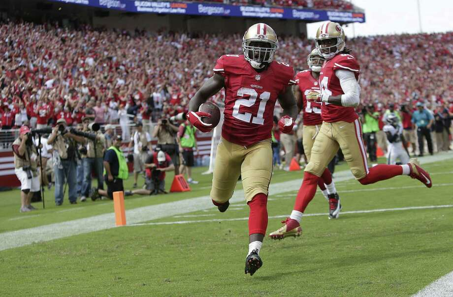 49ers running back Frank Gore scores on a career-best 55-yard touchdown reception. He added 119 rushing yards. Photo: Marcio Jose Sanchez / Associated Press / AP