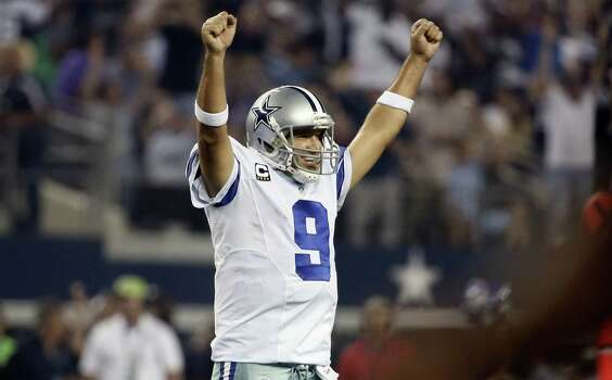 Tony Romo was 22 of 29 for 262 yards and three touchdowns as he helped the Cowboys reach 3-1 for the first time under coach Jason Garrett. Photo: Brandon Wade / Associated Press / FR168019 AP