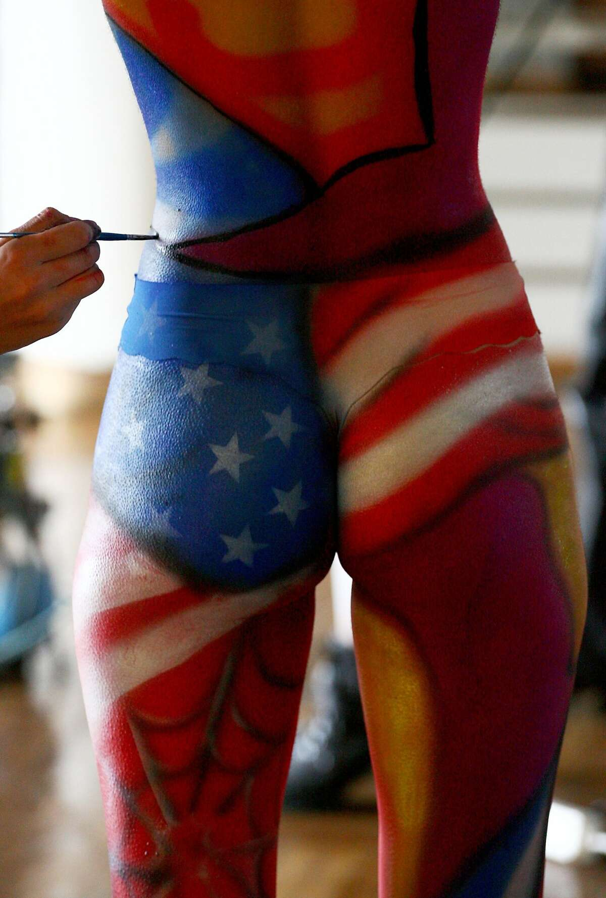 The star-spangled backside: An artist paints the body of a model at the International Tattoo and Body-art Festival in Minsk.
