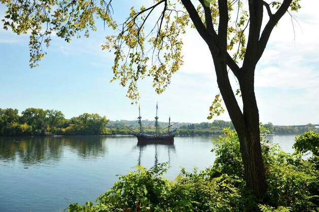 The ship the Half Moon is seen in the Hudson River at the Corning Preserve during the Early Albany: A Hudson River Festival event on Sunday, Sept. 28, 2014, in Albany, N.Y.  The ship is a full-scale, operating replica of the Dutch ship of exploration that Henry Hudson sailed up the Hudson River in 1609.  A historical encampment was created on the banks of the Hudson River where visitors could see demonstrations on how Dutch settlers and the Native Americans in the area lived and worked during the early 1600's.  This year was also the 15th annual Fall of Voyage of Discovery, a trip where local school children and Dutch school children sailed the ship up the river, conducting science experiments along the way.    (Paul Buckowski / Times Union) Photo: Paul Buckowski / 00028422A