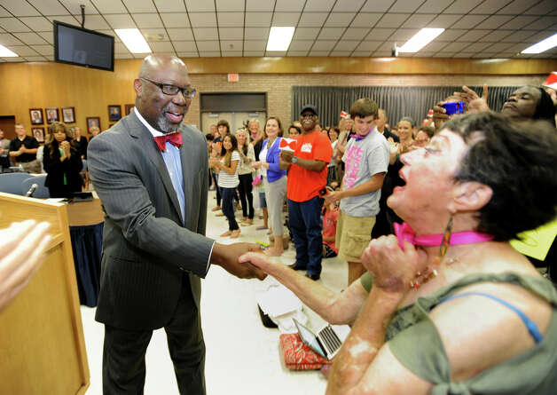 Michael Williams the commissioner of the Texas Education Agency holds is greeted by the audience during BISD's board meeting Monday night. Photo taken Monday, July 21. 2104 Guiseppe Barranco/@spotnewsshooter Photo: Guiseppe Barranco, Photo Editor