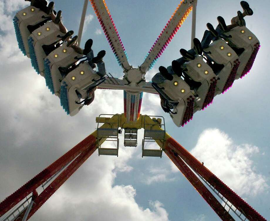 The Freakout takes fairgoers on a wild ride at the 2007 Texas Rice Festival in Winnie. Enterprise file photo Photo: TAMMY MCKINLEY / Beaumont