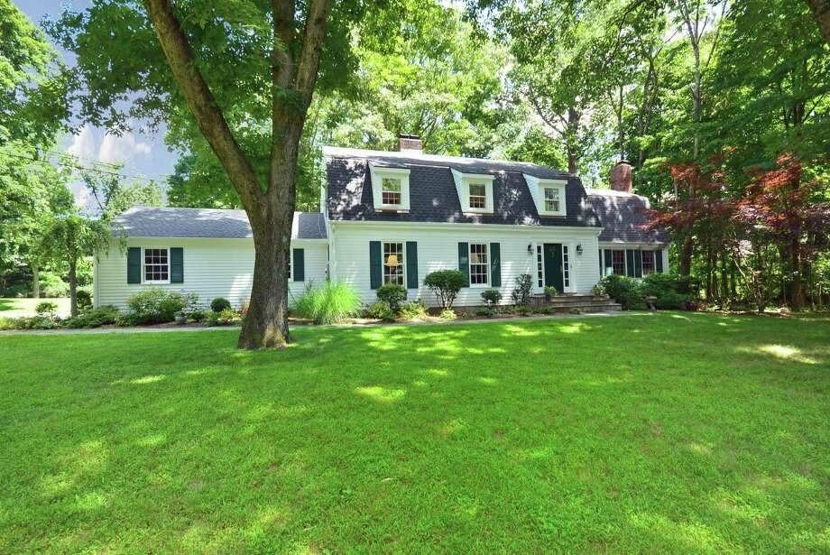 This classic five-bedroom Colonial located on a private lane across from the Country Club of New Canaan is on the market for $1.4 million. Photo: Contributed Photo, Contributed / New Canaan News Contributed