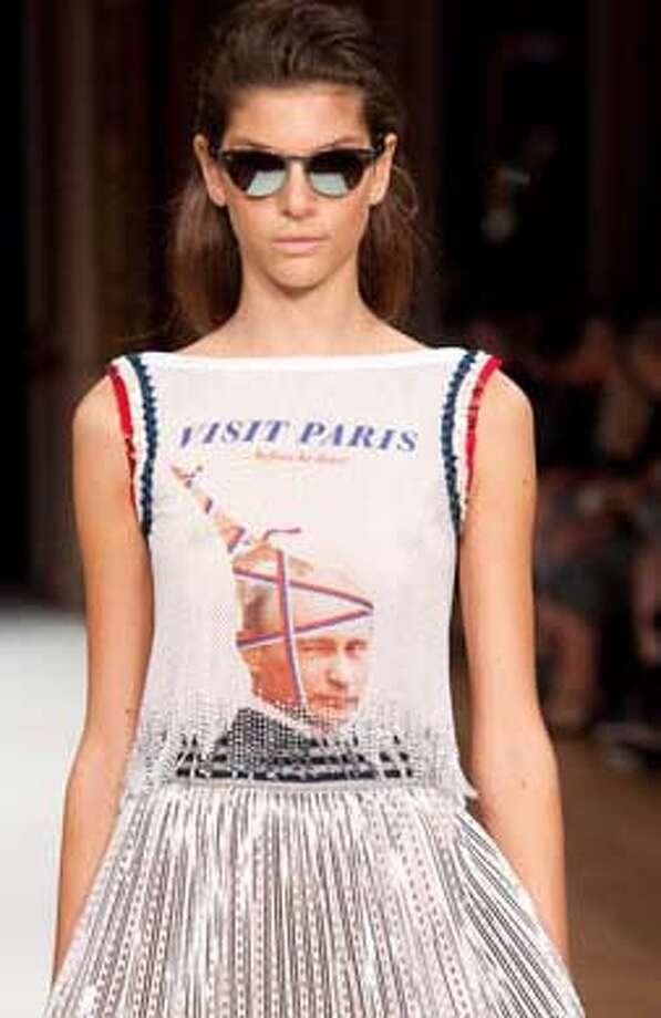 Odd embellishments  These Vladimir Putin-themed travel shirts are the greatest. They are also the creepiest. Suddenly we do not want to go to Paris. Photo: Kay-Paris Fernandes, Getty Images / 2014 Kay-Paris Fernandes