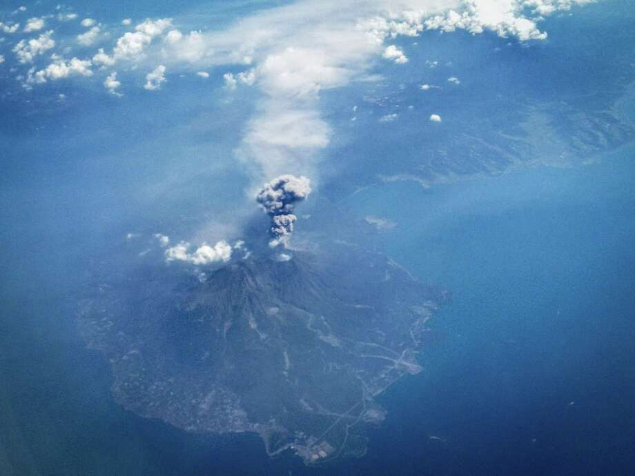 A volcano erupts over Mount Ontake in Japan. Rescuers have found five more bodies near the summit, bringing the death toll to 36. Only 12 bodies have been airlifted off the mountain since the eruption. Photo: Chris McGrath / Getty Images / 2014 Getty Images