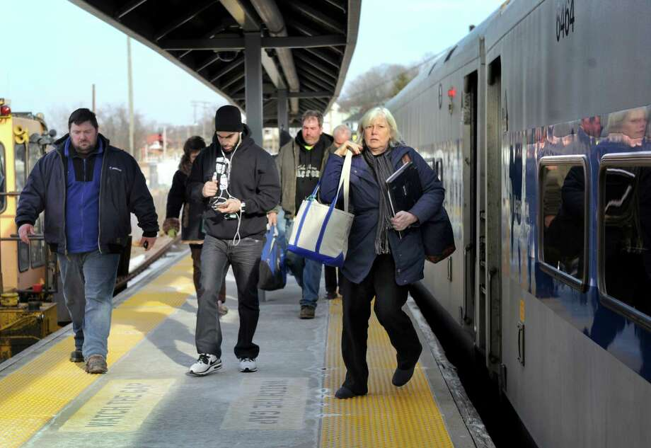 Passengers disembark from the 5:15 p.m. Metro-North train at the Danbury train station earlier this year. Photo: Carol Kaliff / The News-Times