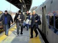 Passengers disembark from the 5:15 p.m. Metro-North train at the Danbury train station earlier this year.