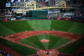 Pittsburgh Pirates starting pitcher Vance Worley delivers during the fifth inning of a baseball game against the Milwaukee Brewers at PNC Park in Pittsburgh Sunday, Sept. 21, 2014. The Pirates announced  they drew 2,442,564 fans to PNC this season, a new franchise record. (AP Photo/Gene J. Puskar)