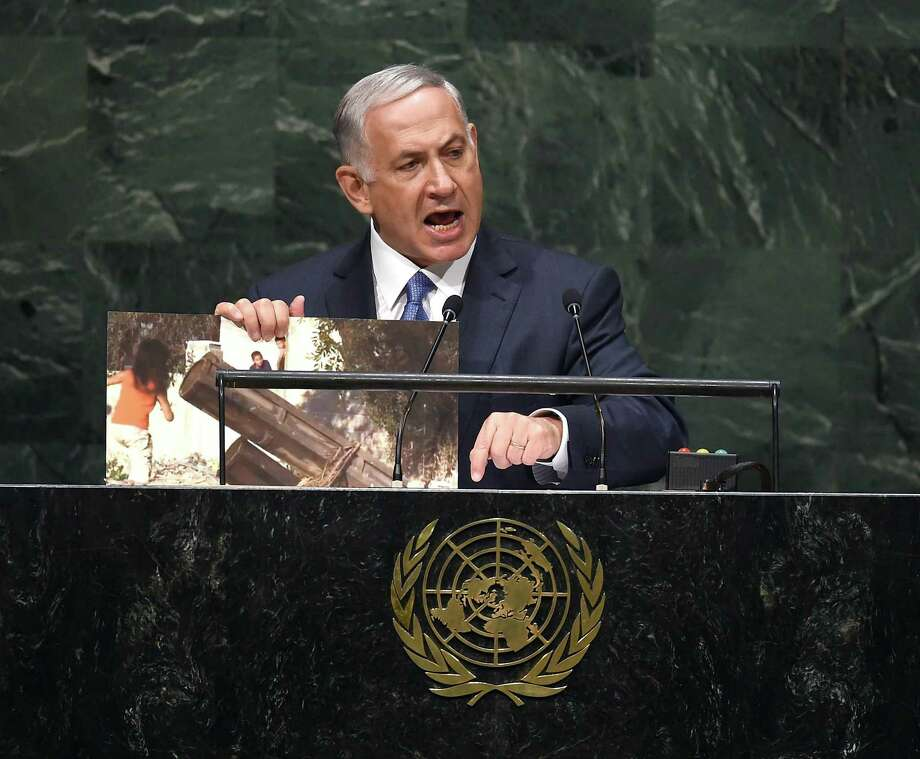 Israeli Prime Minister Benjamin Netanyahu holds up a photo of an alleged Hamas rocket as he addresses the 69th Session of the UN General Assembly Photo: TIMOTHY A. CLARY / AFP/Getty Images / AFP