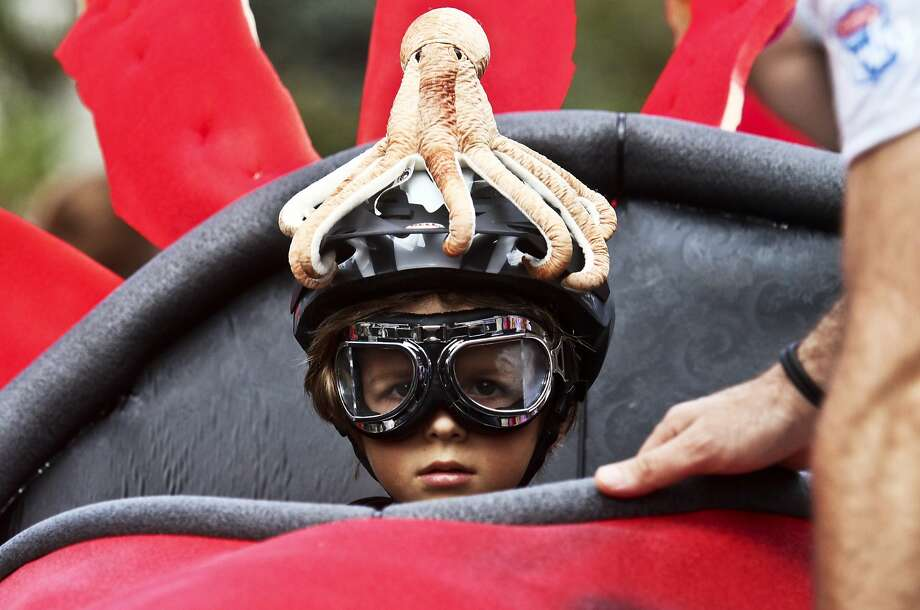 This seat is octopi:A cephalopod-helmeted boy prepares for his run down the course at the Madison Avenue Soapbox Derby in Decatur, Ga. Photo: Ron Harris, Associated Press
