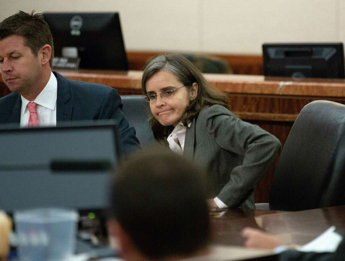 Next to her defense attorney Derek Hollingsworth, Dr. Ana Maria Gonzalez-Angulo, sits in court before the jury deliberated on her sentencing of 10 years in prison and a $10,000 fine in the 248th District Court at the Harris County Criminal Justice Center Monday, Sept. 29, 2014, in Houston. Dr. Gonzalez-Angulo, was convicted for a felony charge of aggravated assault, was charged in May 2013 with poisoning Dr. George Blumenschein. Judge Katherine Cabaniss is presiding over the case.