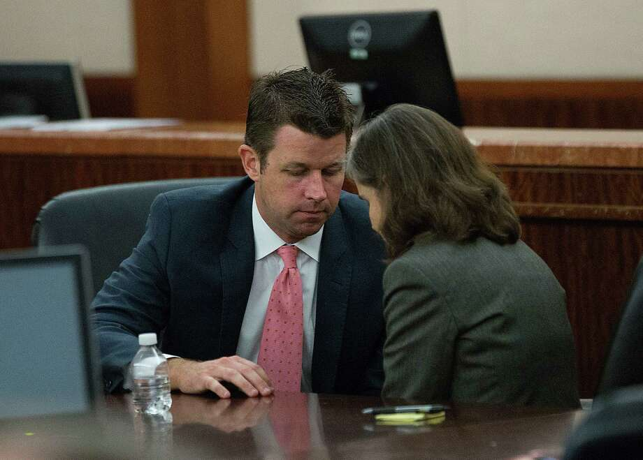 Dr. Ana Maria Gonzalez-Angulo, right, with defense attorney Derek Hollingsworth before her sentencing of 10 years in prison and a $10,000 fine in the 248th District Court at the Harris County Criminal Justice Center Monday, Sept. 29, 2014, in Houston. Dr. Gonzalez-Angulo, was convicted for a felony charge of aggravated assault, was charged in May 2013 with poisoning Dr. George Blumenschein. Judge Katherine Cabaniss is presiding over the case. Photo: Johnny Hanson, Houston Chronicle / © 2014  Houston Chronicle