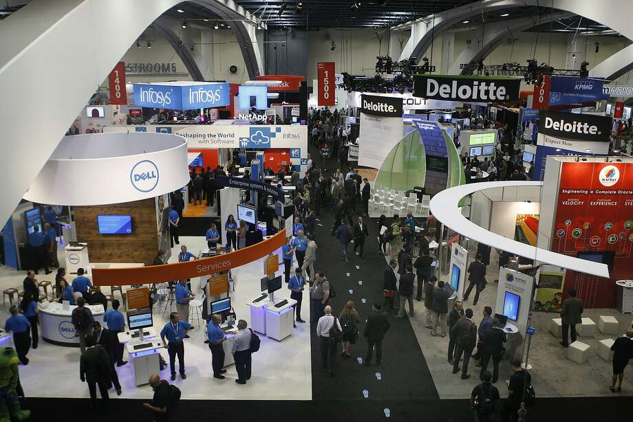 The exhibition hall opens during the first day of Oracle OpenWorld2014 at Moscone Convention Center in San Francisco, Calif., on Monday, September 29, 2014. Photo: Liz Hafalia, The Chronicle