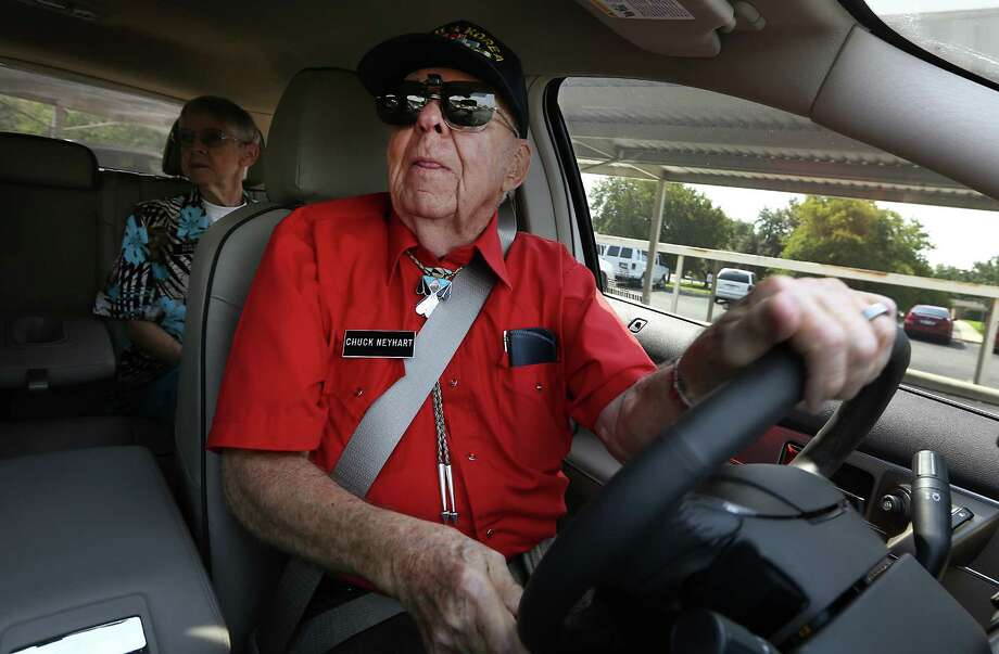 """Chuck Neyhart, right, backs out of a parking lot as his wife Shirley Heyhart, watches him from the backseat. Neyhart's father Amos Neyhart is considered the """"Father of Driver Education"""".  He started the first ever driver training program in the US at Penn State University in 1933.  Monday, September 22, 2014 Photo: BOB OWEN, San Antonio Express-News / © 2014 San Antonio Express-News"""