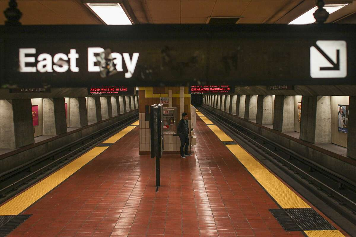 A lone passenger waits for one of the last BART trains back to the East Bay at the 24th Street BART station in San Francisco on September 29th 2014.