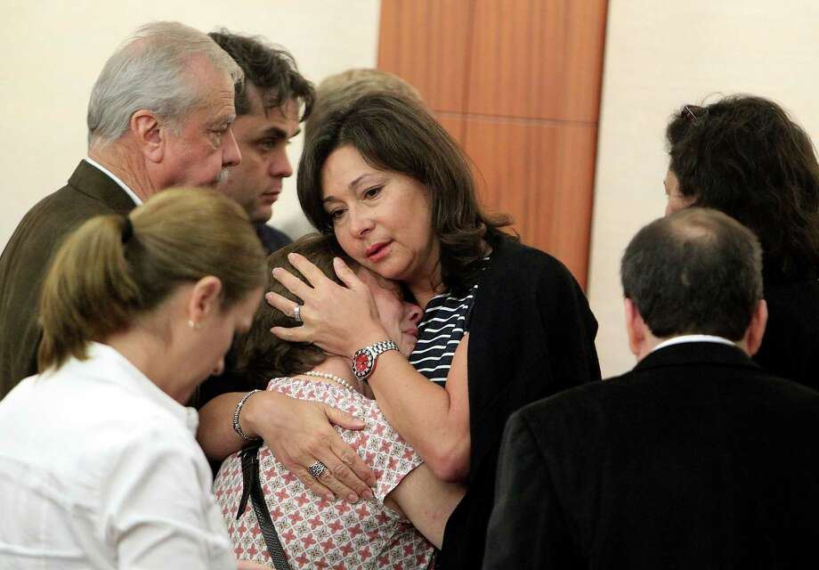 Friends and family of Dr. Ana Maria Gonzalez- Angulo react in the courtroom to her sentencing. Photo: James Nielsen / Associated Press / Houston Chronicle