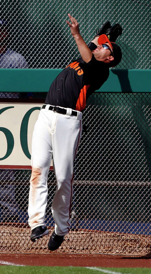 Travis Ishikawa's meager outfield experience includes a grab in a 2011 spring game. Photo: Paul Chinn / The Chronicle / SFC