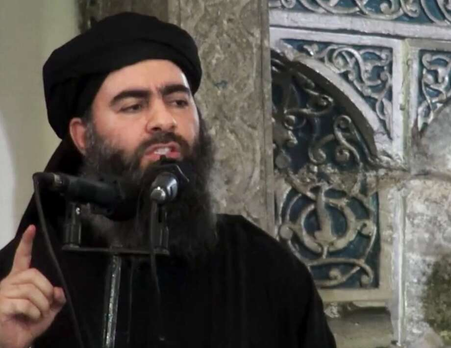 Abu Bakr al-Baghdadi, leader of the Islamic State group, has apparently persuaded his 30,000 fighters to reinstate the caliphate. Photo: Associated Press / Associated Press / Militant video