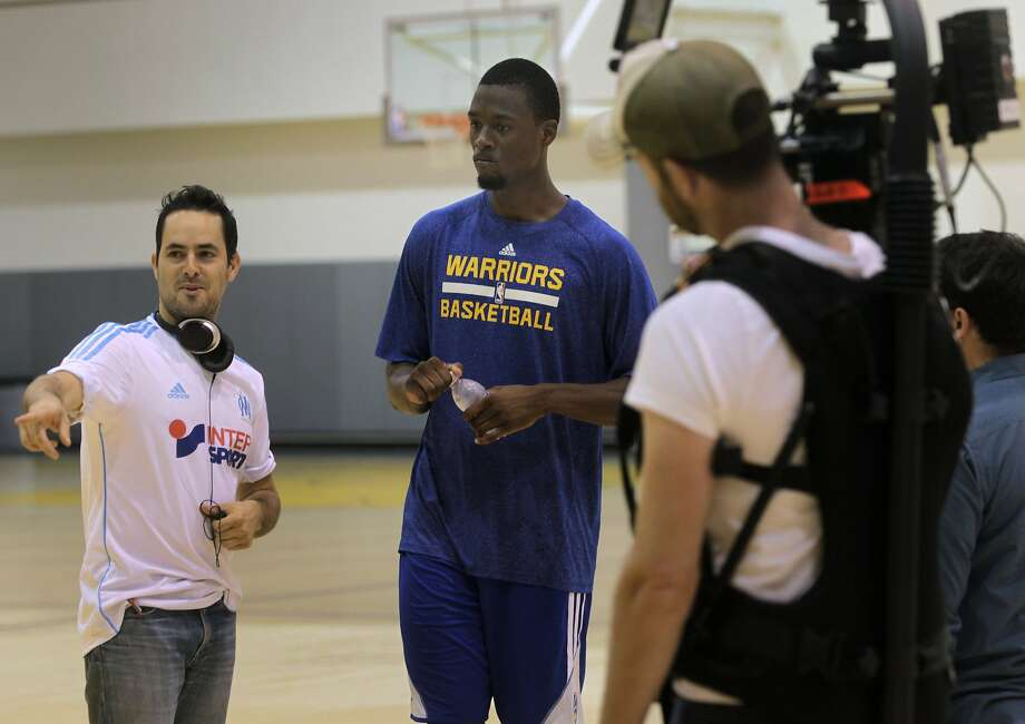 "Morgan Wise (left) directs Golden State Warriors forward Harrison Barnes during a video shoot at the team's training facility in Oakland, Calif. on Friday, Sept. 12, 2014, to promote ""One City"", a new program organized by the San Francisco Citizens Initiative for Technology and Innovation. Photo: Paul Chinn, The Chronicle"