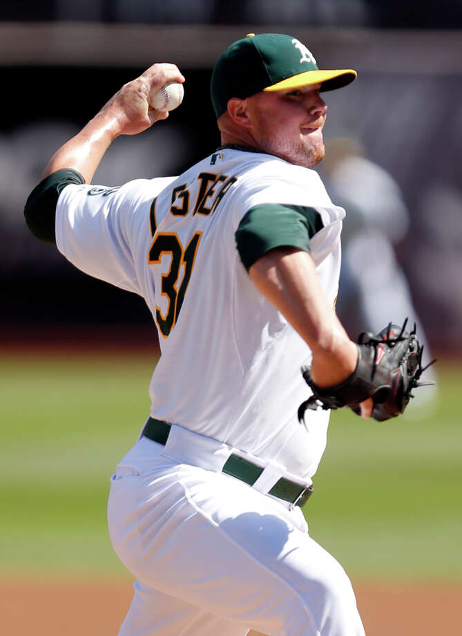 Signing ex-A's left-hander Jon Lester would require the Giants to stretch their salary comfort zone. Photo: Scott Strazzante / The Chronicle / ONLINE_YES